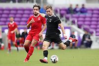 Orlando, Florida - Saturday January 13, 2018: Jon Gallagher is chased by Thomas Vancaeyezeele. Match Day 1 of the 2018 adidas MLS Player Combine was held Orlando City Stadium.