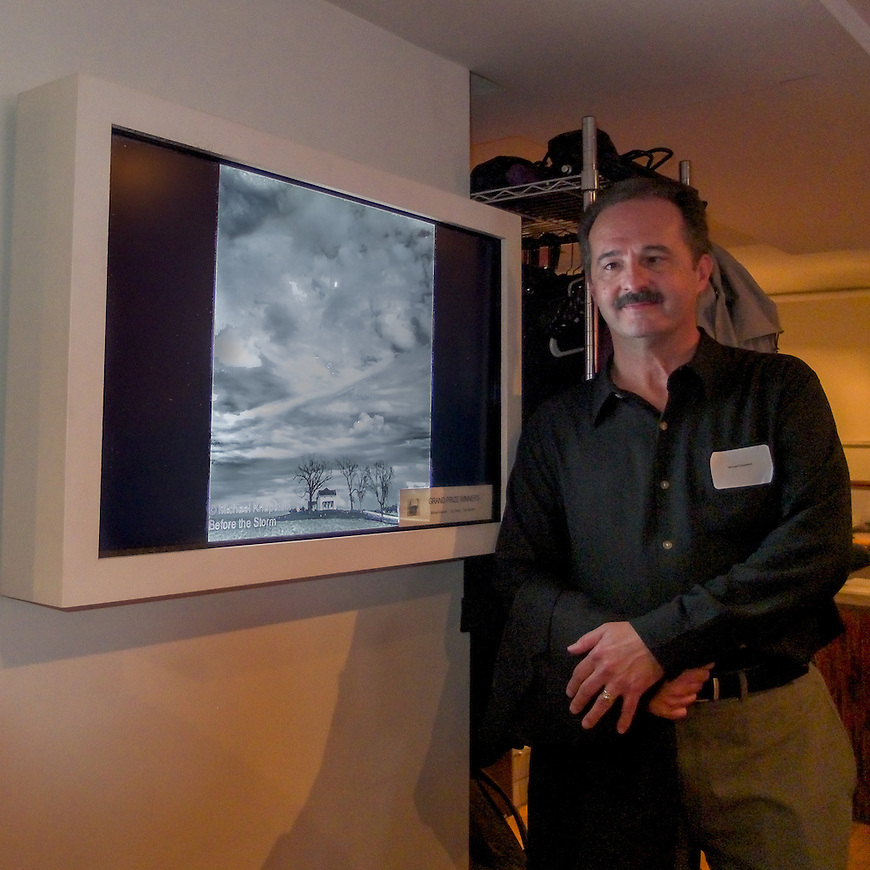 Michael Knapstein standing next to his Grand Prize award-winning photograph in the SoHo Gallery of Digital Art in New York City, where his work was exhibited in September, 2013 after winning Grand Prize in a juried competition from the New York Center for Photographic Art.