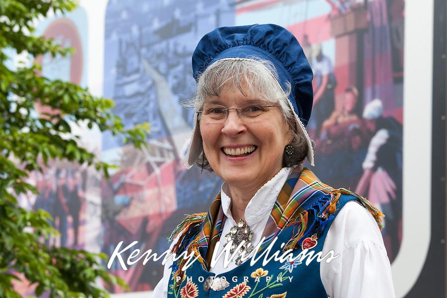 Woman wearing traditional Norwegian clothing, 17th of May Festival 2016, Ballard, Seattle, WA, USA.