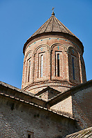 "Close up pictures & imagse of the cupola of Timotesubani medieval Orthodox monastery Church of the Holy Dormition (Assumption), dedcated to the Virgin Mary, 1184-1213, Samtskhe-Javakheti region, Georgia (country).<br /> <br /> Built during the reigh of Queen Tamar during the ""Golden Age of Georgia"", Timotesubani Church of the Holy Dormition is one of the most important examples of medieval Georgian architecture and art. <br /> <br /> Built of pinkish Georgian brick to a cruciform floor plan. The eastern end of the church has 3 apses. Above the centre of the church is a high Georgian style cupola supported on 2 columns."