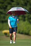 TAOYUAN, TAIWAN - OCTOBER 26:  Inbee Park of South Korea shelters from the sun under an umbrella on the 9th hole during the day two of the Sunrise LPGA Taiwan Championship at the Sunrise Golf Course on October 26, 2012 in Taoyuan, Taiwan. Photo by Victor Fraile / The Power of Sport Images