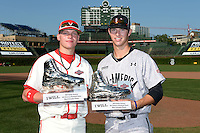 Pitcher / Outfielder Alex Verdugo of Sahuaro High School in Tucson, Arizona (left) and Pitcher Grant Hockin of Damien High School in Pomona, California pose with their teams respective MVP trophies after the Under Armour All-American Game on August 24, 2013 at Wrigley Field in Chicago, Illinois.  (Mike Janes/Four Seam Images)