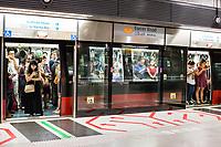 Singapore MRT Mass Rapid Transit Passengers Waiting for Train to Depart.