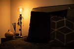 """© Joel Goodman - 07973 332324 - all rights reserved . 12/01/2020 . Salford , UK . Bedside lamp and dreamcatcher in the master bedroom of the rented flat of Kayne Lewis (25) , which he shares with Chase (the 5 month old Chihuahua) and some fish , in apartment block """"Duet"""" , on Salford Quays in Greater Manchester . Photo credit : Joel Goodman"""