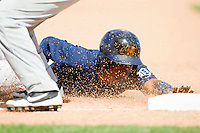 Danry Vasquez (13) of the West Michigan Whitecaps slides head first into third base with a triple against the Quad Cities River Bandits at Fifth Third Ballpark on May 5, 2013 in Comstock Park, Michigan.  The River Bandits defeated the Whitecaps 5-4.  (Brian Westerholt/Four Seam Images)