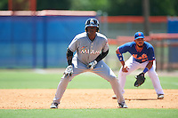 GCL Marlins left fielder Sleyter Soto (11) leads off in front of first baseman Carlos Sanchez (21) during a game against the GCL Mets on August 12, 2016 at St. Lucie Sports Complex in St. Lucie, Florida.  GCL Marlins defeated GCL Mets 8-1.  (Mike Janes/Four Seam Images)