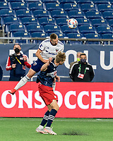 FOXBOROUGH, MA - APRIL 24: Russell Canouse #6 of D.C. United and Adam Buksa #9 of New England Revolution battle for head ball during a game between D.C. United and New England Revolution at Gillette Stadium on April 24, 2021 in Foxborough, Massachusetts.