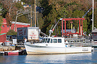 A lobster boat anchored at the dock operations of Oyster River Lobster in Rockport, Maine.