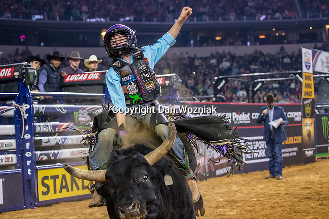 Youth bull riders in action during the WinStar Casino and Resort Iron Cowboy bull riding event, at the AT & T stadium in Arlington, Texas.