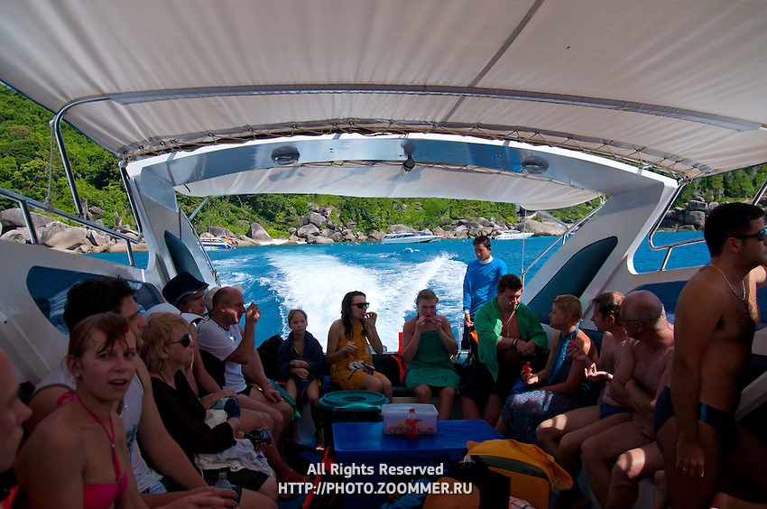 Tourists with snacks on speedboat in Thailand