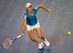 January 30, 2010. Justine Henin of Belgium, in action, during her 6-4, 3-6, 6-2 loss to Serena Williams, of the USA, in the final of the Women's Singles Championship of The Australian Open, Melbourne Park, Melbourne, Australia