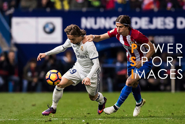Luka Modric of Real Madrid fights for the ball with Filipe Luis of Atletico de Madrid during their La Liga match between Atletico de Madrid and Real Madrid at the Vicente Calderón Stadium on 19 November 2016 in Madrid, Spain. Photo by Diego Gonzalez Souto / Power Sport Images
