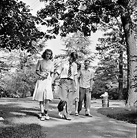High school students strolling through the zoological park. Detroit, Michigan, July 1942.<br /> <br /> Photo by Arthur S. Siegel.