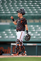 GCL Orioles catcher Jose Montanez (31) signals to the defense during the first game of a doubleheader against the GCL Twins on August 1, 2018 at CenturyLink Sports Complex Fields in Fort Myers, Florida.  GCL Twins defeated GCL Orioles 7-6 in the completion of a suspended game originally started on July 31st, 2018.  (Mike Janes/Four Seam Images)