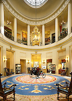 The interior of the London's Royal Automobile Club. In the rotunda is a 1900 Simms, a car built by Frederick Simms, one of the club's founders, is displayed.