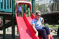 Jenna Martin of Bella Vista rides down a slide, Sunday, September 5, 2021 at Horsebarn Trailhead Park in Rogers. Check out nwaonline.com/210906Daily/ for today's photo gallery. <br /> (NWA Democrat-Gazette/Charlie Kaijo)