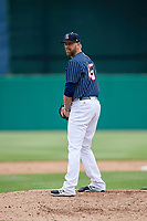 Syracuse Chiefs relief pitcher Justin Miller (15) gets ready to deliver a pitch during a game against the Lehigh Valley IronPigs on May 20, 2018 at NBT Bank Stadium in Syracuse, New York.  Lehigh Valley defeated Syracuse 5-2.  (Mike Janes/Four Seam Images)