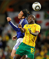 Marcus Tulio Tanaka of Japan and Pierre Webo of Cameroon