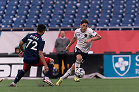 FOXBOROUGH, UNITED STATES - MAY 28: Ignacio Poplawski #34 of Fort Lauderdale CF brings the ball forward during a game between Fort Lauderdale CF and New England Revolution II at Gillette Stadium on May 28, 2021 in Foxborough, Massachusetts.
