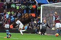 Andre Ayew of Swansea City scores the winning goal 1-2 as Goalkeeper Brad Guzan of Aston Villa looks dejected  during the Barclays Premier League match between Aston Villa v Swansea City played at the Villa Park Stadium, Birmingham on October 24th 2015