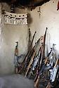 Kurdistan Irak 1985<br /> Dans les zones libérées, entrée d'une maison avec les armes des invites, les peshmergas , et les couverts de la famille<br /> Iraki Kurdistan 1985<br /> In liberated areas, guns and spoons in the entrance of a private house