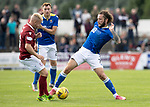 Arbroath v St Johnstone…15.08.21  Gayfield Park      Premier Sports Cup<br />Stevie May tackles Nicky Low<br />Picture by Graeme Hart.<br />Copyright Perthshire Picture Agency<br />Tel: 01738 623350  Mobile: 07990 594431