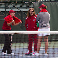 STANFORD, CA - February 25, 2011:  Nicole Gibbs and Mallory Burdette celebrate their wins with Head Coach Lele Farood during Stanford's 7-0 victory over Oregon at Stanford, California on February 25, 2011.