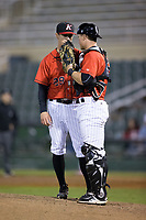 Kannapolis Intimidators catcher Nate Nolan (22) had a discussion on the mound with relief pitcher Danny Dopico (29) during the game against the Lakewood BlueClaws at Kannapolis Intimidators Stadium on April 8, 2017 in Kannapolis, North Carolina.  The BlueClaws defeated the Intimidators 8-4 in 10 innings.  (Brian Westerholt/Four Seam Images)