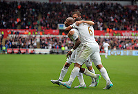 Pictured: Andre Ayew of Swansea celebrates his equaliser with team mates Sunday 30 August 2015<br /> Re: Premier League, Swansea v Manchester United at the Liberty Stadium, Swansea, UK
