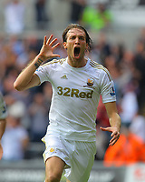 FAO SPORTS PICTURE DESK<br /> Pictured: Michu of Swansea celebrating his goal. Saturday 25 August 2012<br /> Re: Barclay's Premier League Swansea City FC v West Ham at the Liberty Stadium, south Wales.