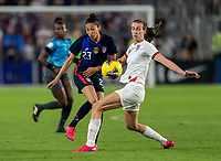 ORLANDO, FL - MARCH 05: Christen Press #23 of the United States crosses the ball past Jill Scott #8 of England during a game between England and USWNT at Exploria Stadium on March 05, 2020 in Orlando, Florida.
