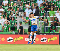 AUSTIN, TX - JUNE 19: Matt Besler #5 of Austin FC attempts to head the ball over Andres Rios #25 of the SJ Earthquakes during a game between San Jose Earthquakes and Austin FC at Q2 Stadium on June 19, 2021 in Austin, Texas.