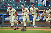 The Florida State Seminoles bench rushes the field after the final out in the 2017 ACC Baseball Championship Game against the North Carolina Tar Heels at Louisville Slugger Field on May 28, 2017 in Louisville, Kentucky. The Seminoles defeated the Tar Heels 7-3. (Brian Westerholt/Four Seam Images)
