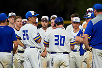South Dakota State Jackrabbits head coach Rob Bishop (26) talks with his team after a game against the Northeastern Huskies on February 23, 2019 at North Charlotte Regional Park in Port Charlotte, Florida.  Northeastern defeated South Dakota State 12-9.  (Mike Janes/Four Seam Images)