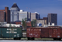 Greensboro, NC, North Carolina, Freight train travels past the skyline of downtown Greensboro