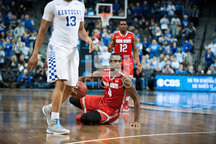 BROOKLYN, NY - Saturday December 19, 2015: Daniel Giddens (#4) of Ohio State fought for a ball from Isaiah Briscoe (#13) of Kentucky before a foul was called as the two teams square off in the CBS Classic at Barclays Center in Brooklyn, NY.