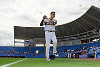 Michigan Wolverines Hector Gutierrez (24) warms up before the first game of a doubleheader against the Canisius College Golden Griffins on June 20, 2016 at Tradition Field in St. Lucie, Florida.  Michigan defeated Canisius 6-2.  (Mike Janes/Four Seam Images)
