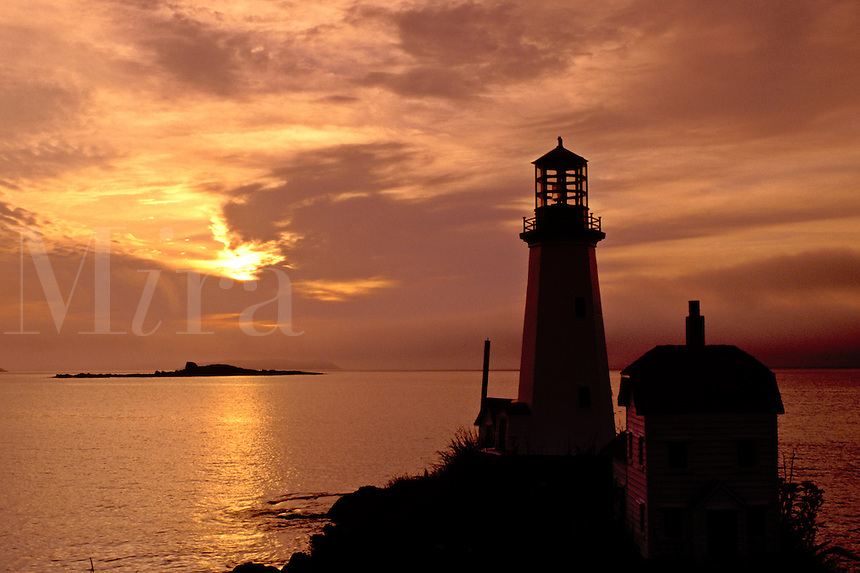 lighthouse, sunrise, sunset, Newfoundland, NF, Canada, A lighthouse at sunrise in Ship Cove over the Atlantic Ocean.