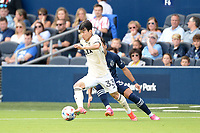 KANSAS CITY, KS - JUNE 26: Moon-hwan Kim #33 Los Angeles FC with the ball during a game between Los Angeles FC and Sporting Kansas City at Children's Mercy Park on June 26, 2021 in Kansas City, Kansas.