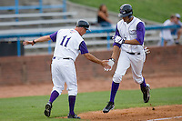 Winston-Salem Dash manager Joe McEwing #11 gives a low-five to Salvador Sanchez #7 as he rounds third base following a solo home run against the Lynchburg Hillcats at Wake Forest Baseball Stadium August 30, 2009 in Winston-Salem, North Carolina. (Photo by Brian Westerholt / Four Seam Images)