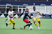 FOXBOROUGH, MA - MAY 16: Teal Bunbury #10 of New England Revolution passes the ball back during a game between Columbus SC and New England Revolution at Gillette Stadium on May 16, 2021 in Foxborough, Massachusetts.