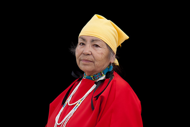 Elder Ardith Peyope (Shoshone-Bannock) dressed in traditional wing dress, beaded choker and scarf on black background