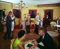 Couples dancing and talking in in piano bar.
