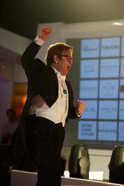 Elton John gives a speech at his White Tie and Tiara Ball