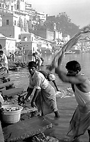 Varanasi (Uttar Pradesh)<br /> <br /> Men washing by hand clothes in the Ganga river.<br /> <br /> Hommes en train de laver le linge dans le Gange.