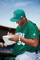 Daytona Tortugas pitcher Keury Mella (34) signs autographs before a game against the Clearwater Threshers on April 20, 2016 at Bright House Field in Clearwater, Florida.  Clearwater defeated Daytona 4-2.  (Mike Janes/Four Seam Images)