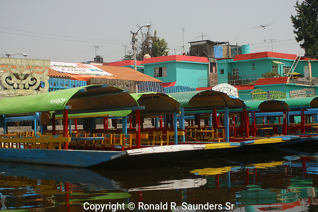 """Xochimilco is one of the sixteen boroughs within Mexican Federal District. Today,the borough consists of eighteen neighborhoods along with fourteen villages that surround it. While the neighbhoods are somewhat in the geographic center of the Federal District, it is considered to be """"south"""" and has an identity separate from the historic center of Mexico City. Xochimilco is best known for its canals, which are left from what was an extensive lake and canal system that connected most of the settlements of the Valley of Mexico. These canals, along with artificial islands called chinampas, attract tourists and other city residents to ride on colorful gondolas called<br /> """"trajineras"""". Its Hispanic past, has made Xochimilco a World Heritage Site.             [UNESCO WORLD HERITAGE SITE] (7)"""
