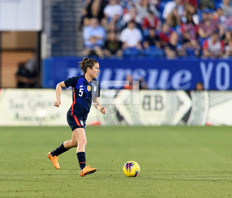 FRISCO, TX - MARCH 11: Kelley O'Hara #5 of the United States brings the ball up the field during a game between Japan and USWNT at Toyota Stadium on March 11, 2020 in Frisco, Texas.
