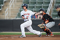 Grant Massey (18) of the Kannapolis Intimidators follows through on his swing against the Delmarva Shorebirds at Kannapolis Intimidators Stadium on April 21, 2016 in Kannapolis, North Carolina.  The Intimidators defeated the Shorebirds 9-3.  (Brian Westerholt/Four Seam Images)