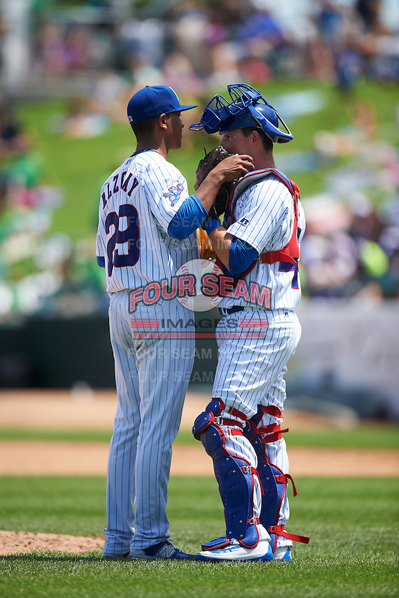 South Bend Cubs starting pitcher Adbert Alzolay (29) talks with catcher Alberto Mineo (47) during the first game of a doubleheader against the Peoria Chiefs on July 25, 2016 at Four Winds Field in South Bend, Indiana.  South Bend defeated Peoria 9-8.  (Mike Janes/Four Seam Images)